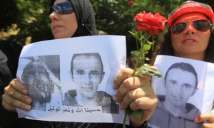 """Image: Women protesting prison sentence of Said's killers Source: The Guardian. """"Anger in Egypt as Police Who Killed Khaled Said Get Seven Years."""" The Guardian. Guardian News, 26 Oct. 2011. Web. 11 Dec. 2013."""