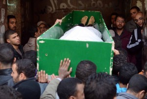 """Image: Family retrieving the dead Source: Abd-Allah, Abdel Halim H. """"In Pictures: Zeinhom morgue post 25 January anniversary.: Daily News Egypt. Daily News Egypt, 27 Jan. 2014. Web. 26 Apr. 2014."""
