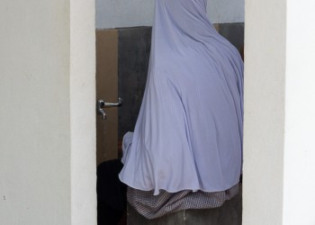 Girl Begins Process of Wudu