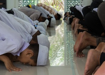 Group of Young Men Participating in Salat