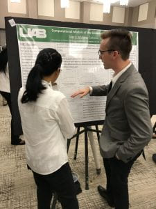 REU Tyler Whitaker talks with a visitor a the 2017 Expo