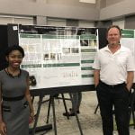 REU Sherilynn Knight with Faculty Mentor Dr. Alan Eberhardt. Sherilynn won 2nd place in the Engineering category at the Expo
