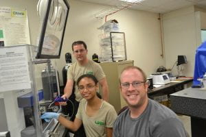 Paige Jackson with Faculty Mentor Dr. Aaron Catledge (l) and Student Mentor Justin Bartlett