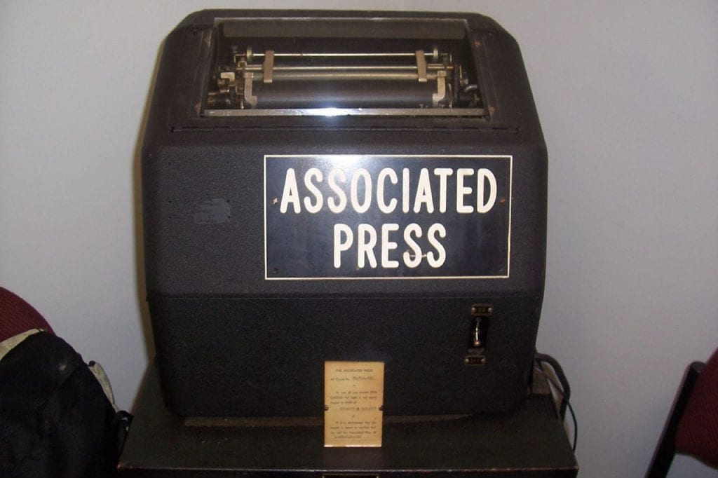 a picture of an old associated press news machine