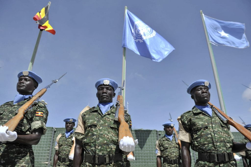 United Nations Guard Unit guard of honor soldiers stand at attention infront of the Ugandan, United Nations and Somalia flags during the Inauguration of the United Nations Guard Unit in Somalia