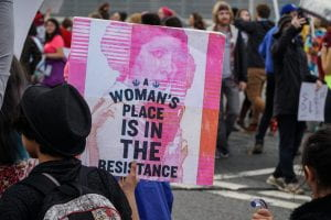a picture of a sign that reads A Women's Place is in the Resistance