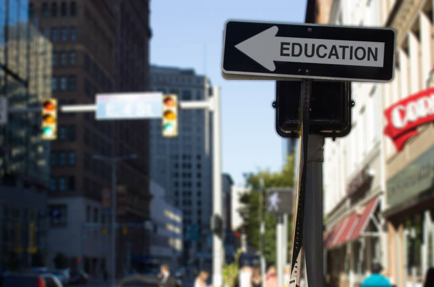 a picture of a one way sign with the word EDUCATION written on it