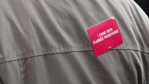 a pic of a sticker that reads I Stand With Planned Parenthood