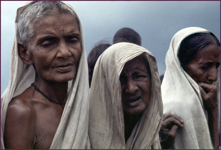 Three refugee Bengali women look sad.