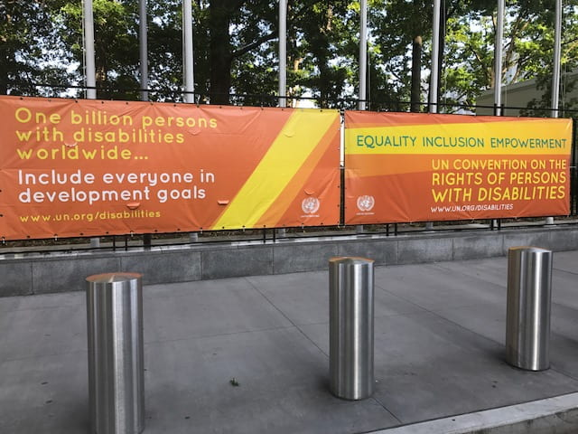 a picture of the CRPD CoSP banner outside of the UN