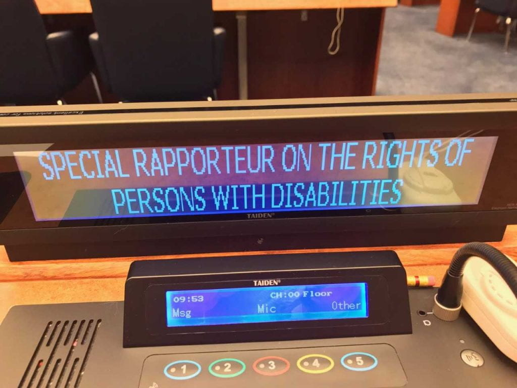 a picture of the rapporteur sign on the UN floor