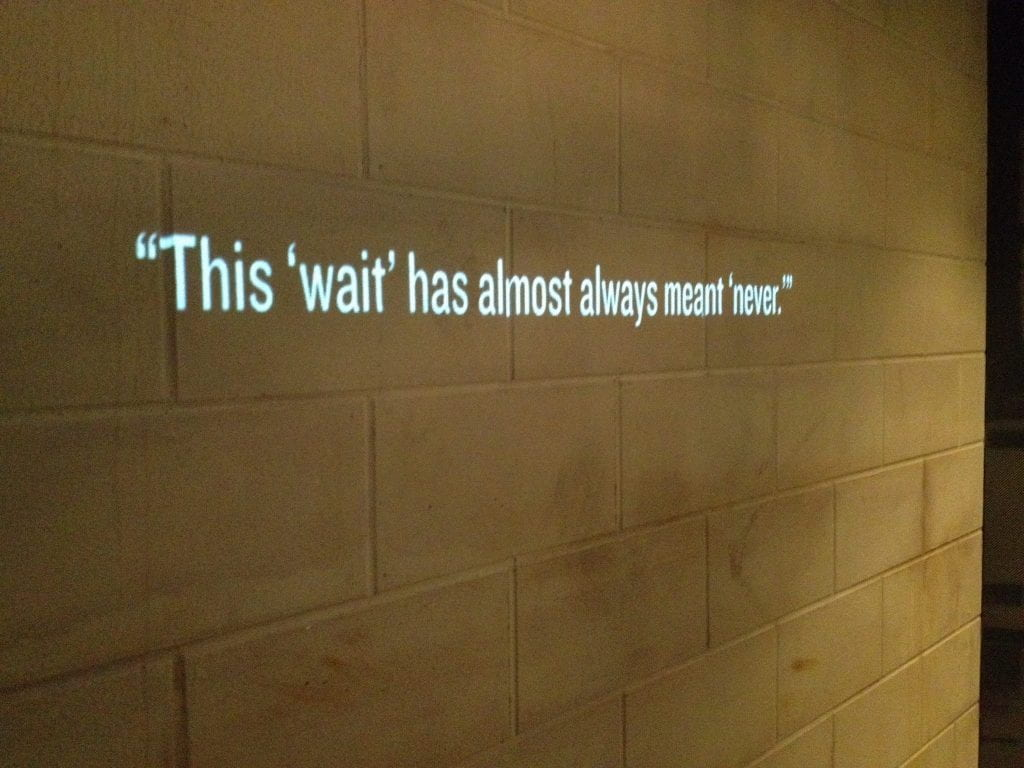"a photo of a line from the Letter from a Birmingham Jail which reads ""this wait has almost always meant never"""