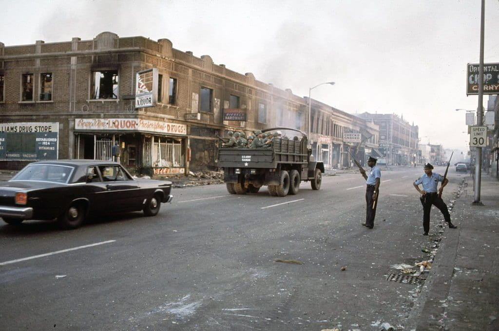 a picture of the National Guard and the police in Detroit, 1967 following the riots
