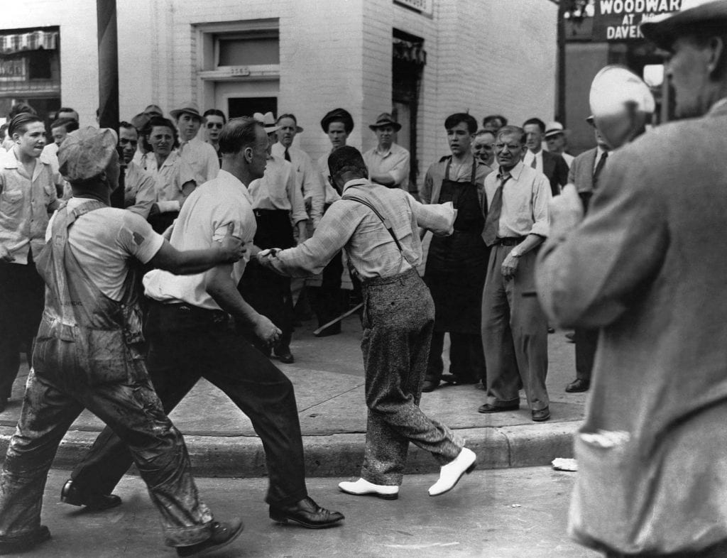 An African American man, the victim of assault during Detroit's race riot tries to escape from a mob before further violence ensues.
