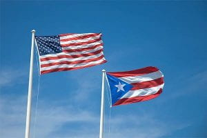A picture of the American and Puerto Rican Flag