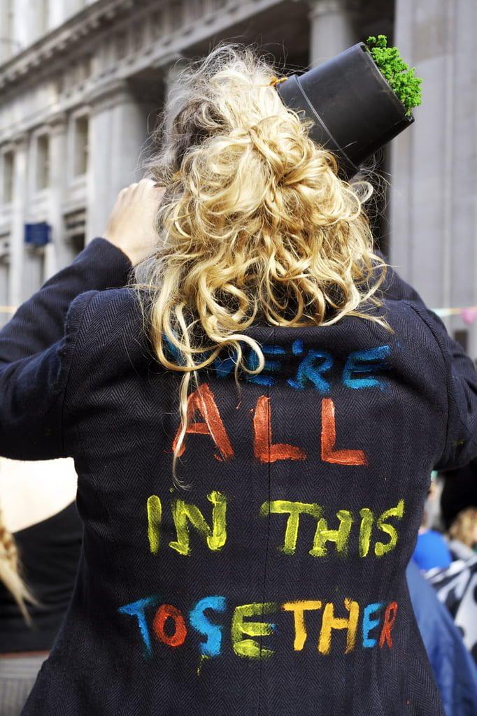 "a photo of a jacket that reads ""we're all in this together"""