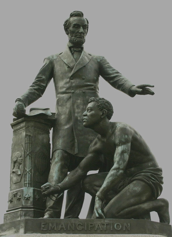 a statue, entitled Emancipation, of Lincoln standing over a kneeling freed slave