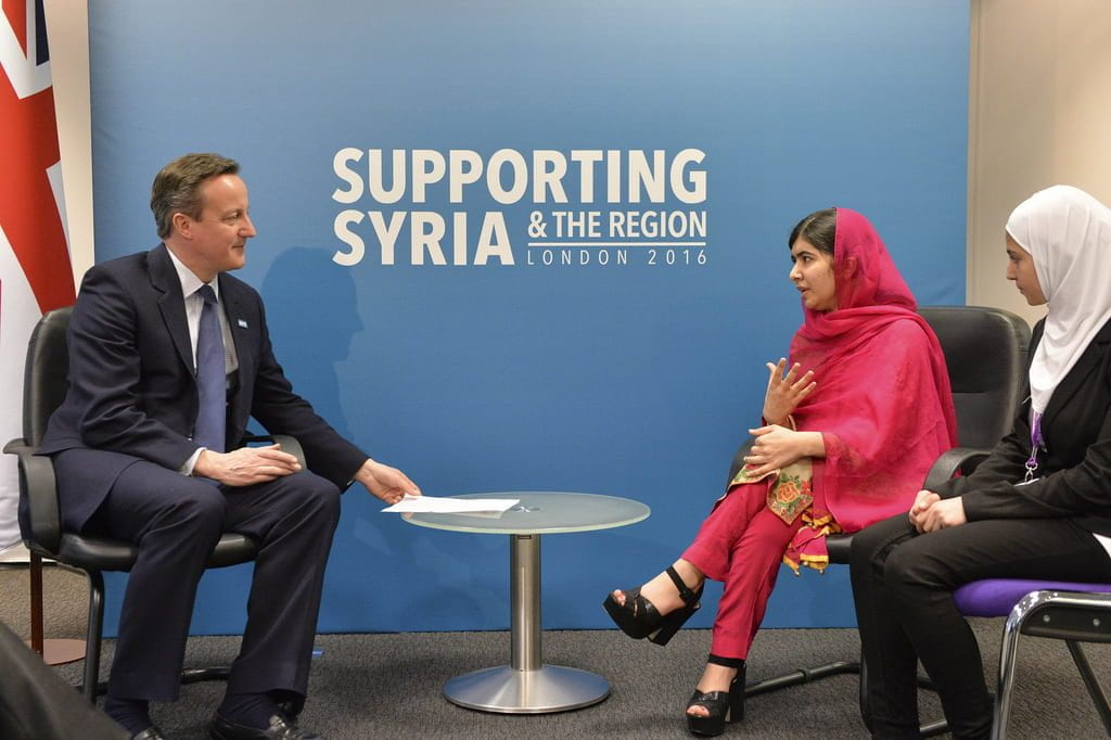 Malala sits and speaks with David Cameron at a conference about Syria