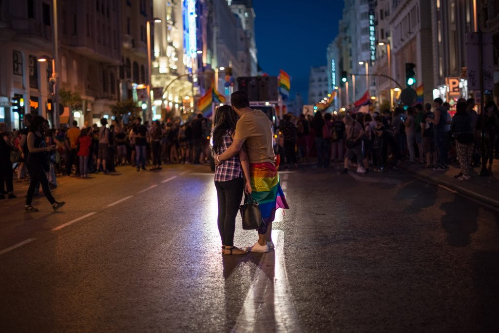 A couple embraces in the street during a gay pride demonstration.