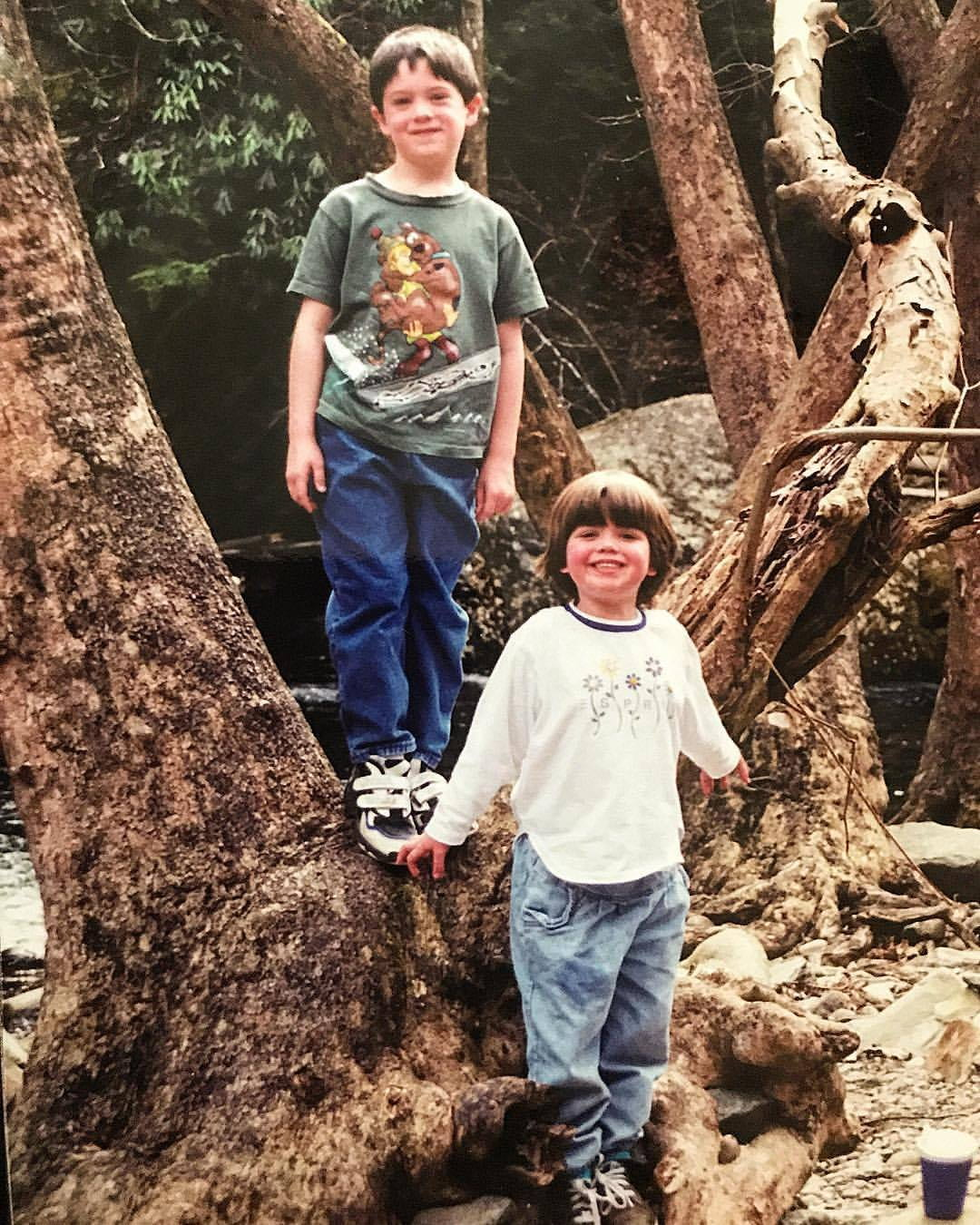 The author and his sister in childhood climbing a tree.