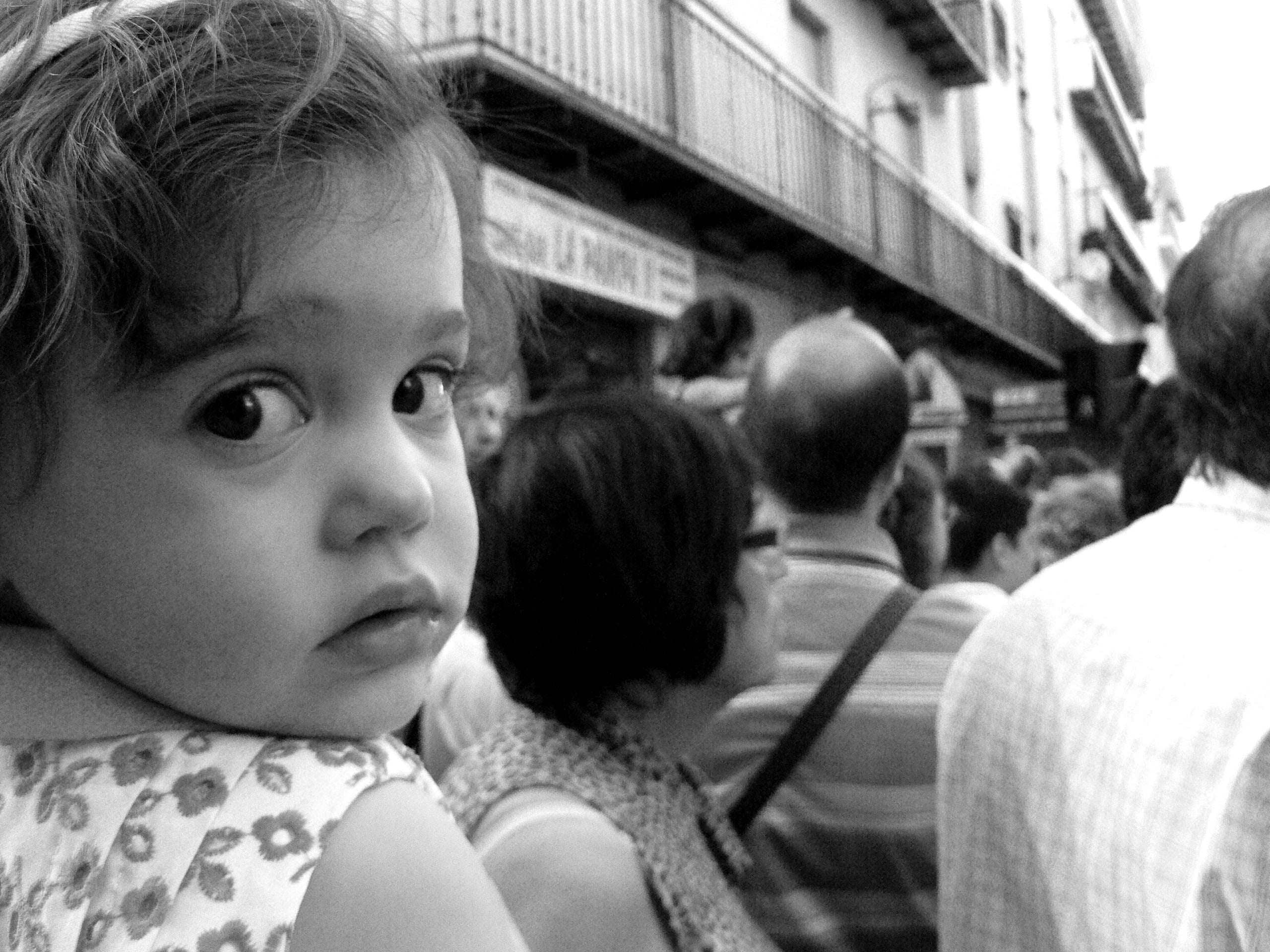 A young girl looking over her shoulder at the camera.