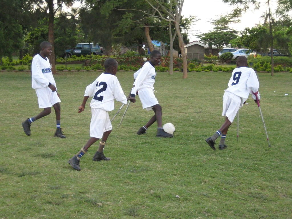 boys with physical disability playing soccer