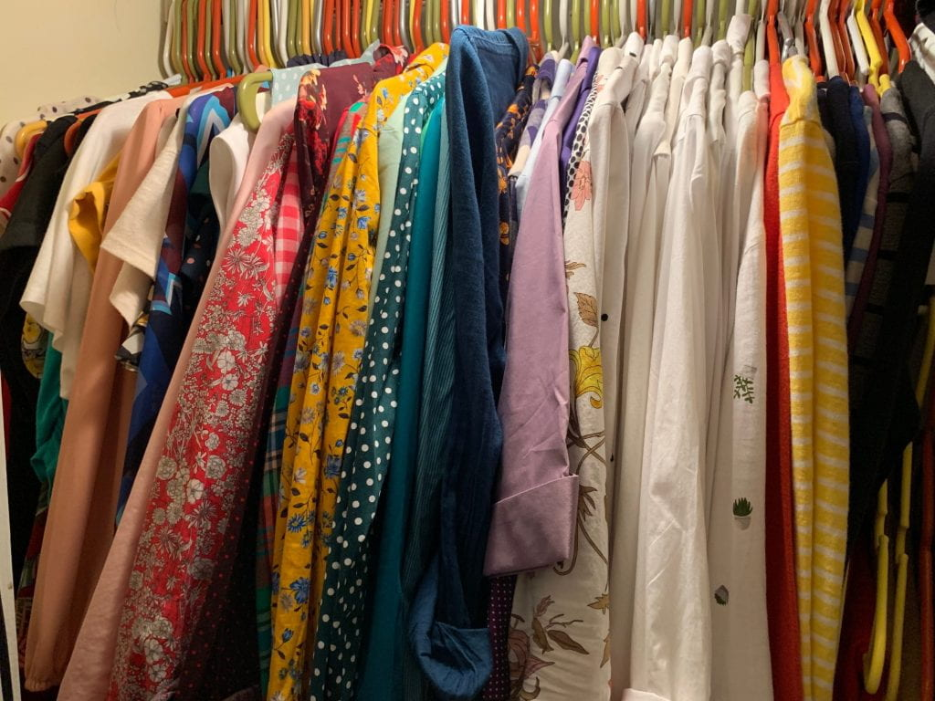 a picture of clothing in a closet
