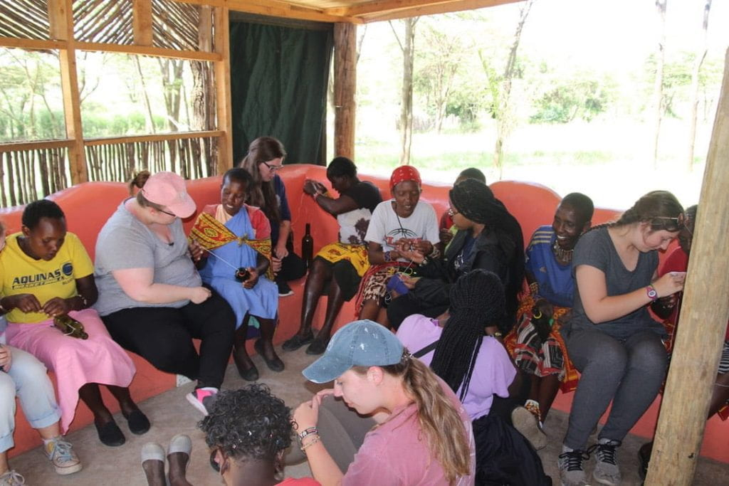 Emma and the Maasai women sitting in a circle having conversation