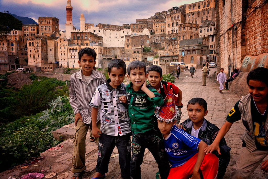 Image of small group of young smiling boys in Jibla, Yemen