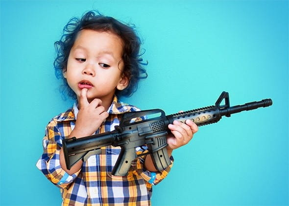A child holding a gun