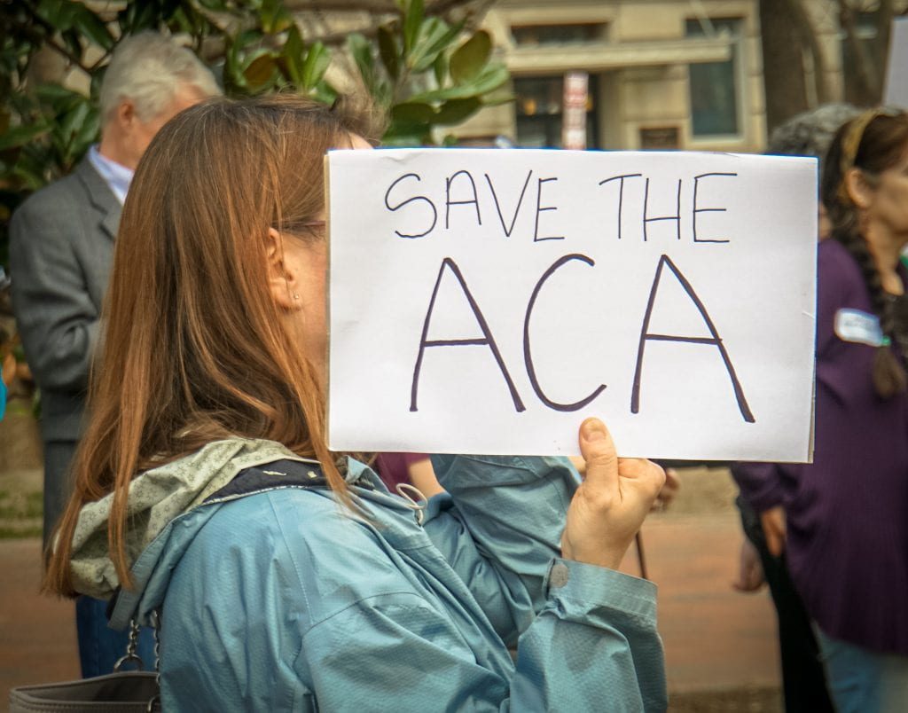 "a photo that reads ""Save the ACA."""
