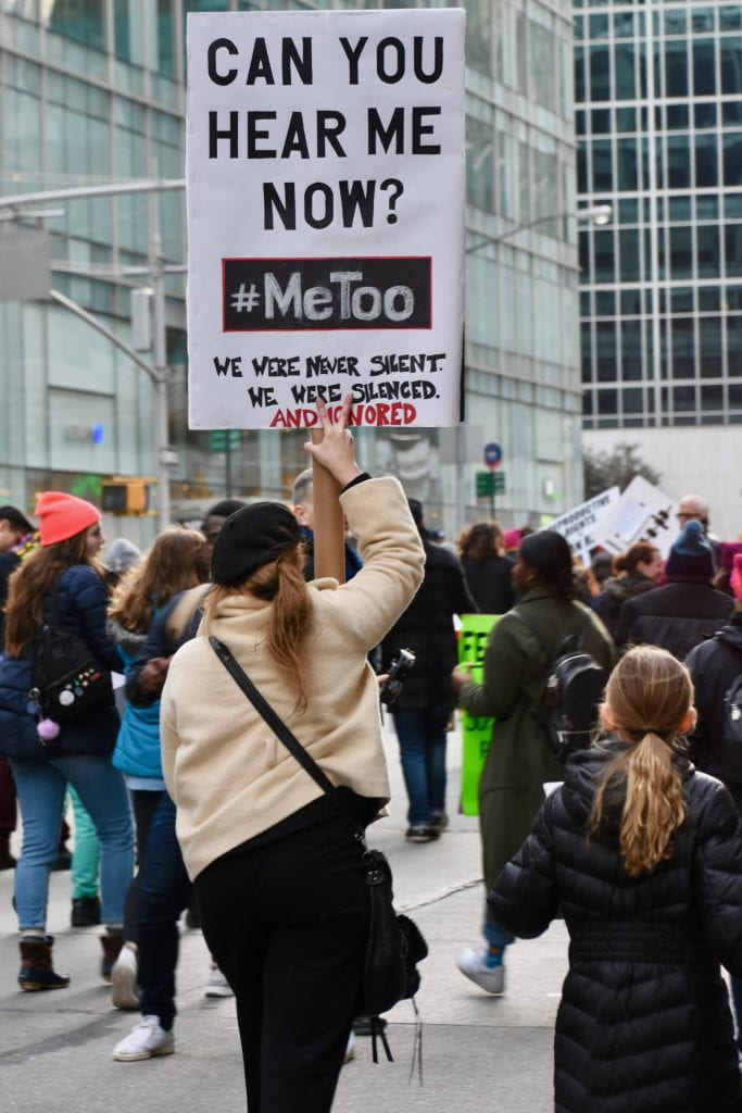 "a protest sign that reads ""Can you hear me now? #MeToo"