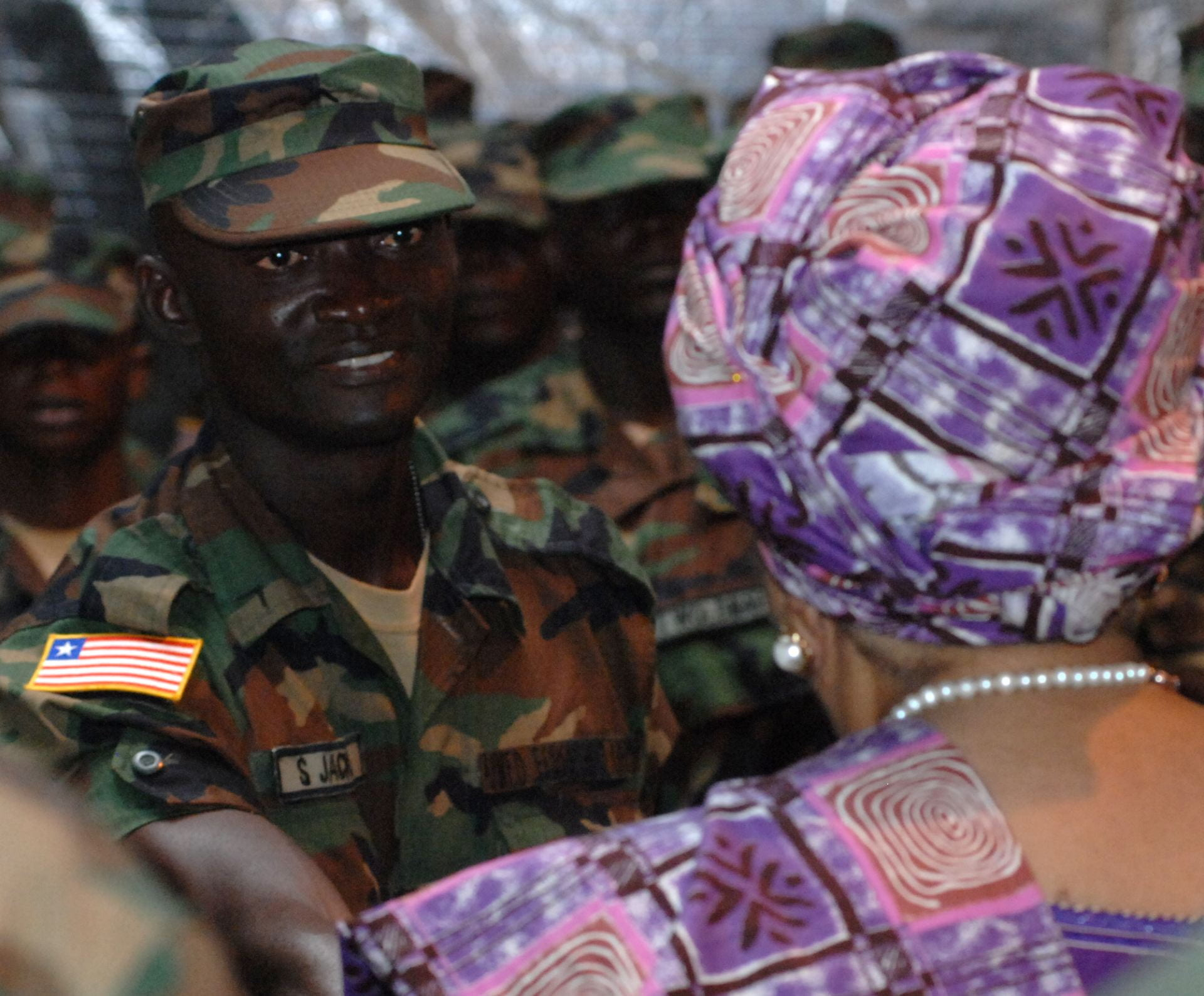 Liberia President Ellen Johnson Sirleaf greets an Armed Forces of Liberia soldiers. Source: DVIDSHUB, Creative Commons