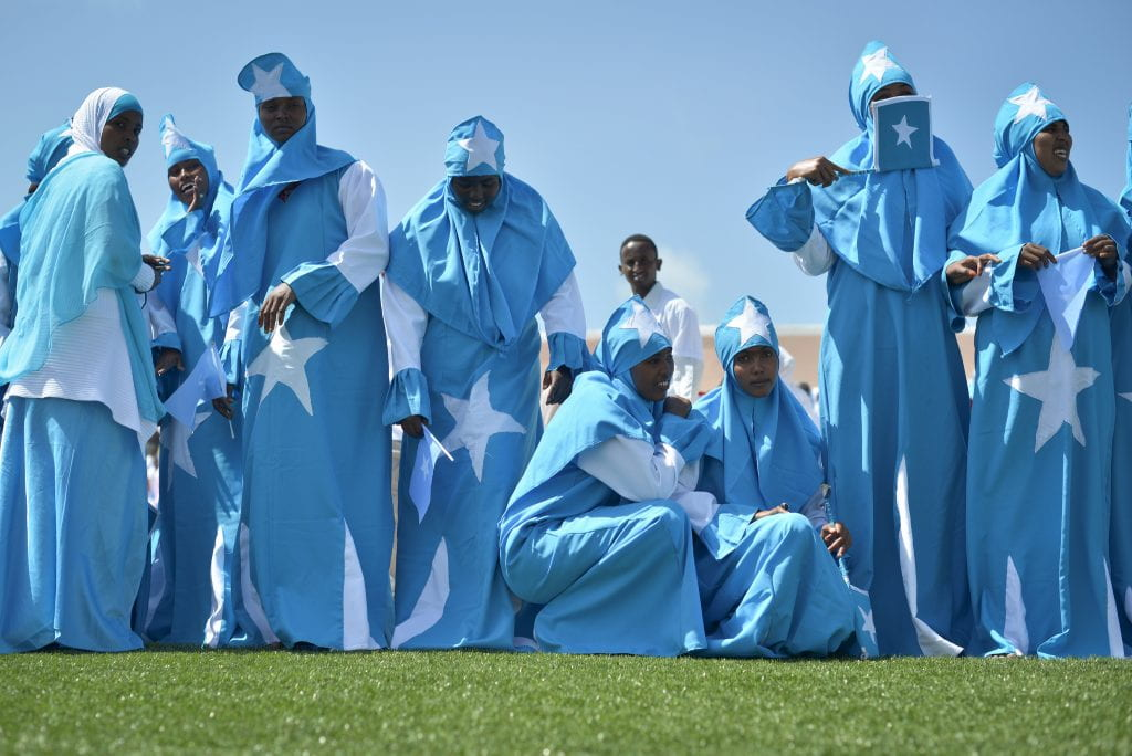 Women adorned in Somali flags celebrate Somalia's Independence Day at Konis stadium in Mogadishu on July 1. Today's celebrations mark 53 years since the Southern regions of Somalia gained independence from Italy and joined with the Northern region of Somaliland to create Somalia