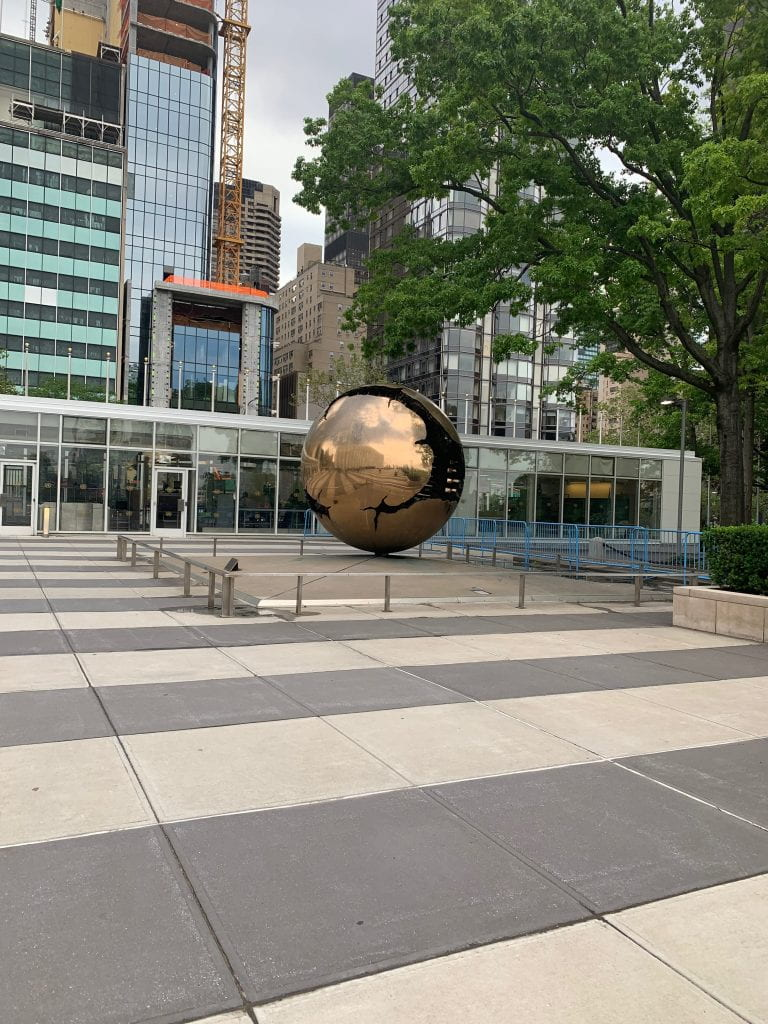 Image showing a sculpture of a globe outside the United Nations building in New York.