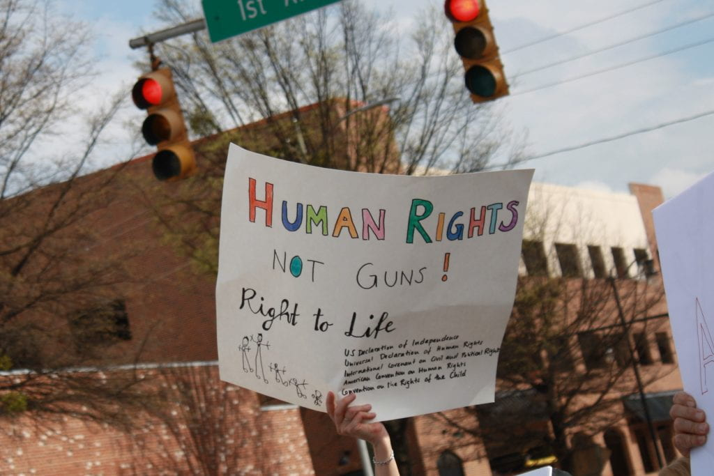 "a picture of a sign that reads ""Human rights not guns: Right to Life"""
