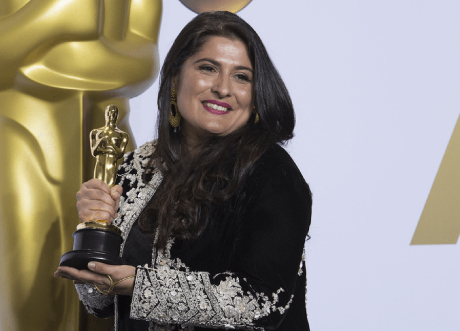 Sharmeen Obaid-Chinoy smiles and poses with her newly won oscar.
