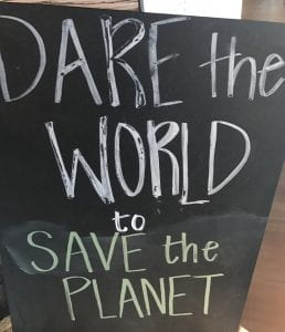 "Chalkboard reading: ""Dare the World to Save the Planet"""