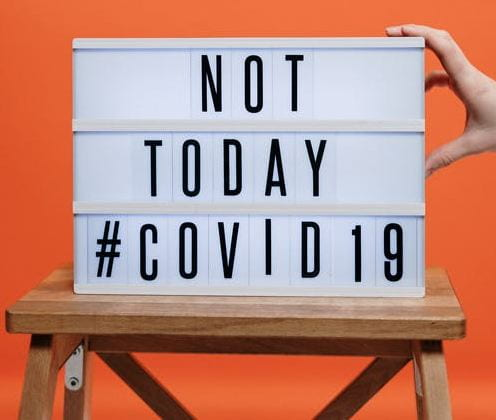 Not Today #COVID19 Sign Resting on a Wooden Stool.