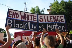 "Protest sign reads ""End White Silence. Black Lives Matter"""