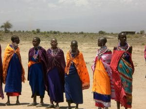 A group of girls dressed in traditional Masaai clothing