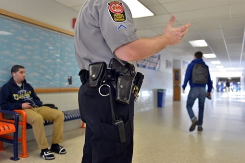 Photo of police officer in a school hallway