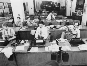 Black and white photo of the New York Times newsroom in 1942, Men in suits sit behind desks
