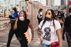Women at a protest -shows POC women activists