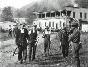 miners surrender arms to troops