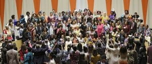 A photograph of dozens of African women at a leadership conference