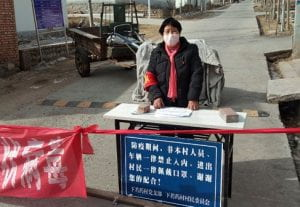 Yan Shenglian volunteered along with 28,000 rural women to monitor COVID-19 in her village. Source: Yahoo Images.