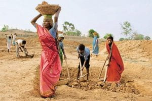 Rural women in India performing their daily duties. Source: Yahoo Images.