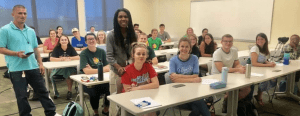 Photo of Dena Dickerson and students in class