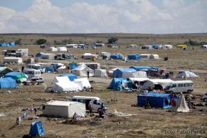 Image of a refugee camp in turkey; dozens of makeshifts tents on a field
